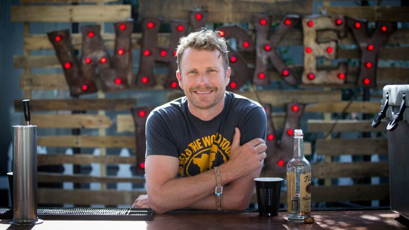 Country singer-songwriter Dierks Bentley hangs out at the Whiskey Bar he takes on tour with him before his headlining set Friday at the Stagecoach country music festival in Indio.