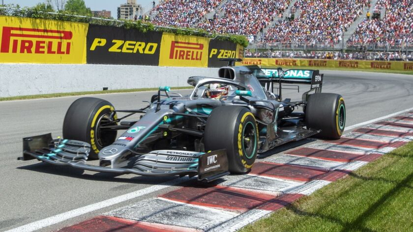 Mercedes driver Lewis Hamilton, of Britain, comes through the Senna corner to start the Formula One