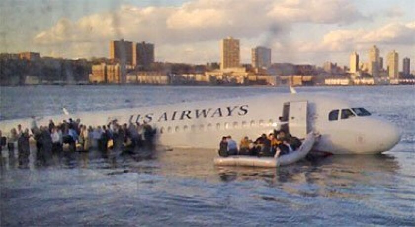A passenger on a Hudson River ferry that was among the first vessels to reach the downed Airbus A320 snapped a photo of the plane's passengers waiting for help on a raft and the wing. All 155 people aboard survived the emergency landing near midtown Manhattan yesterday. (Janis Krums / Associated Pr