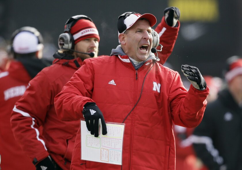 FILE - In a Friday, Nov. 28, 2014 file photo, Nebraska head coach Bo Pelini reacts during the second half of an NCAA college football game against Iowa, in Iowa City, Iowa. Pelini was fired as Nebraska's football coach on Sunday, Nov. 30, 2014, after a seven-year stint. (AP Photo/Charlie Neibergall, File)