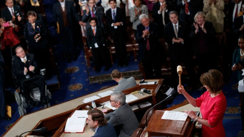 Rep. Nancy Pelosi (D-San Francisco) wields the gavel again as speaker of the House.