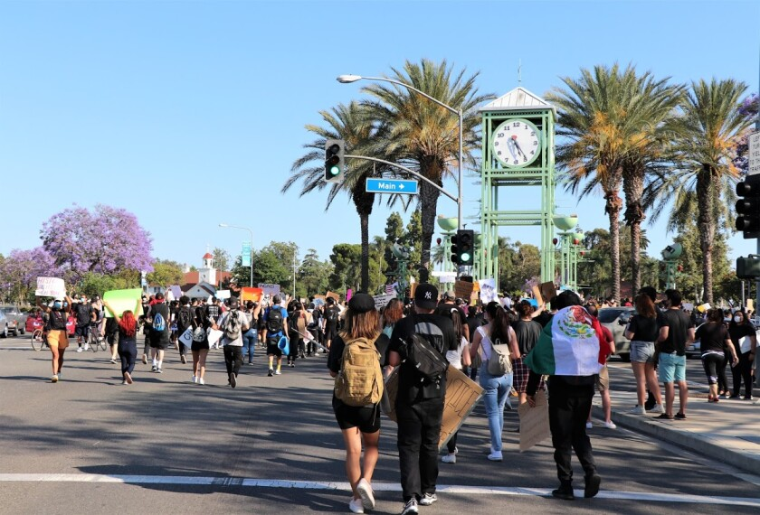 Protesters return to the clock tower at Village Green Park after marching around Garden Grove on June 3.