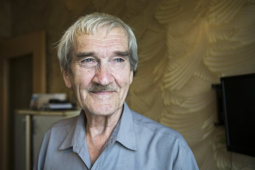 In this Thursday, Aug. 27, 2015 photo former Soviet missile defense forces officer Stanislav Petrov poses for a photo at his home in Fryazino, Moscow region, Russia, Thursday, Aug. 27, 2015. On Sept. 26, 1983, despite the data coming in from the Soviet Union's early-warning satellites over the United States, Petrov, a Soviet military officer, decided to consider it a false alarm. If he had decided otherwise, the Soviet leadership could have responded by ordering a retaliatory nuclear strike on the United States. (AP Photo/Pavel Golovkin)
