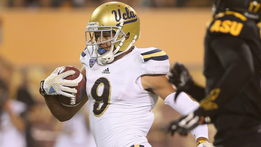 UCLA wide receiver Jordan Payton scores on an 80-yard touchdown reception during a win over Arizona State on Thursday. Payton has emerged as one college football's top receivers.