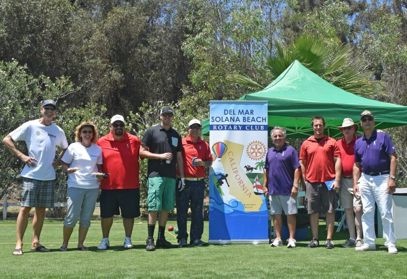 Del Mar-Solana Beach Rotary members with Tony Perez, (at right of poster in purple shirt) Operation Game On founder, at the recent event. Courtesy photo