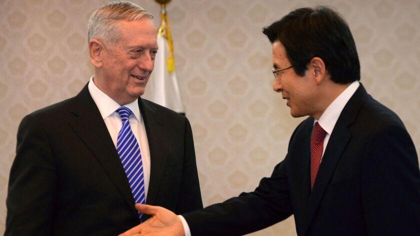 Acting South Korean President Hwang Kyo-ahn, right, greets Defense Secretary James Mattis prior to their meeting Feb. 2 in Seoul.