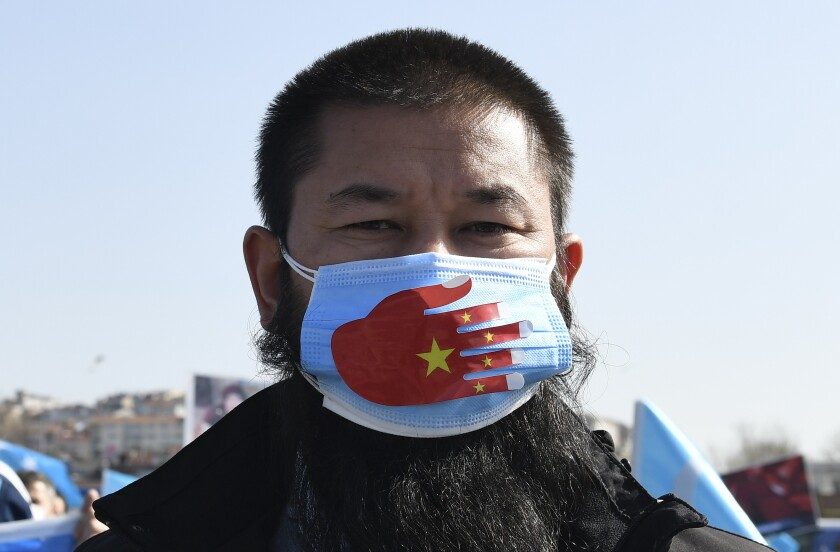 A man wears a mask at a protest.