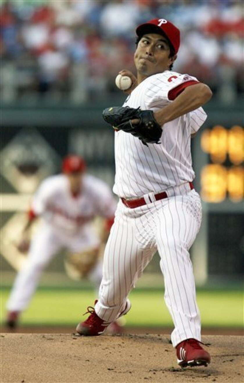 Philadelphia Phillies starting pitcher Rodrigo Lopez throws against the Cincinnati Reds in the first inning of a baseball game, Wednesday, July 8, 2009, in Philadelphia. (AP Photo/H. Rumph, Jr.)