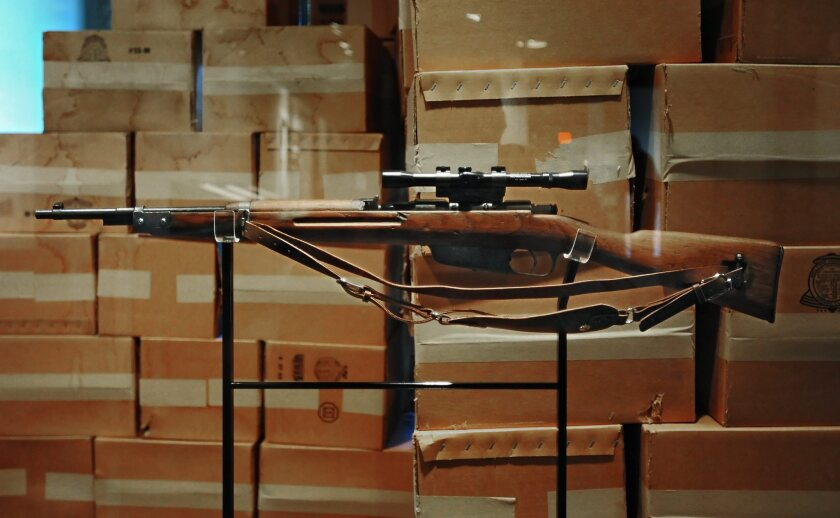 A rifle like the one Lee Harvey Oswald used to assassinate President Kennedy is on display at the Sixth Floor Museum in Dallas.
