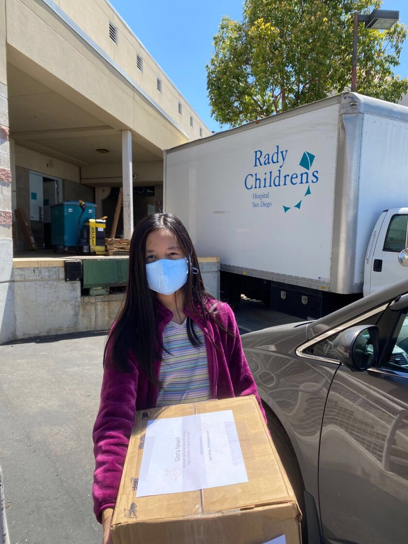 A volunteer from Carmel Valley donates masks from Joey's Wings to Rady Children's Hospital.
