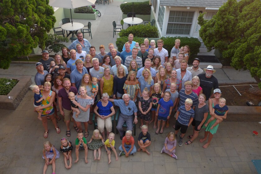 An aerial photo of Rena and Pete de Jong gathered with their children and grandchildren in Pacific Beach.
