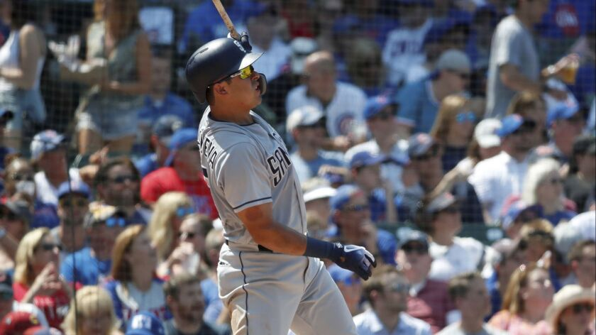 San Diego Padres' Christian Villanueva watches his solo home run during the fourth inning of a baseb
