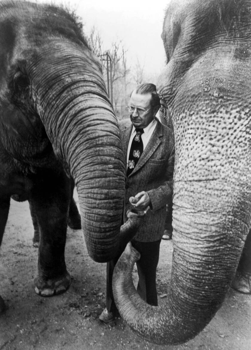 Theodore H. Reed, shown with Asian elephants at the National Zoo in Washington, D.C., in 1983, was at the forefront of the transformation of zoos from barred enclosures into verdant, open showcases.