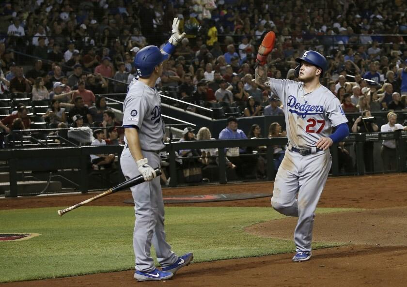 Los Angeles Dodgers' Alex Verdugo (27) celebrates his run scored against the Arizona Diamondbacks wi