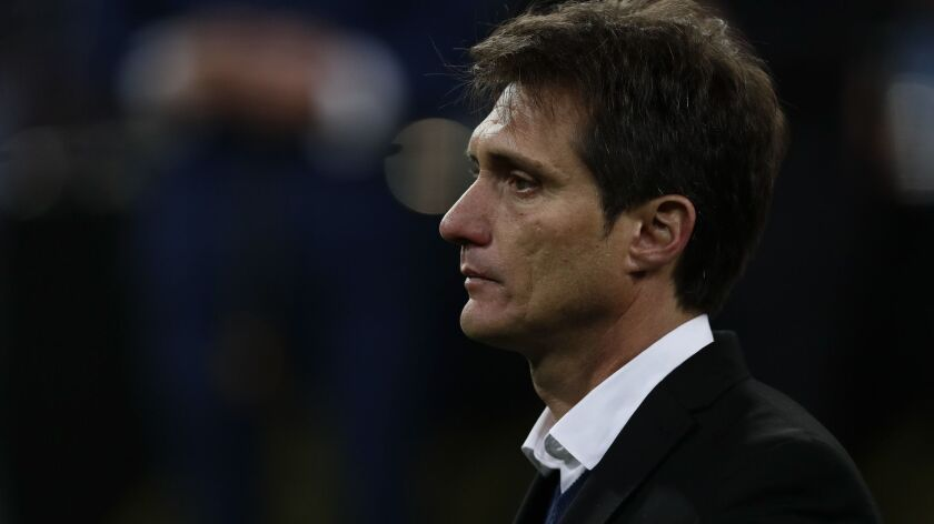 Guillermo Barros Schelotto, coach of Argentina's Boca Juniors, stands in the pitch after his team's