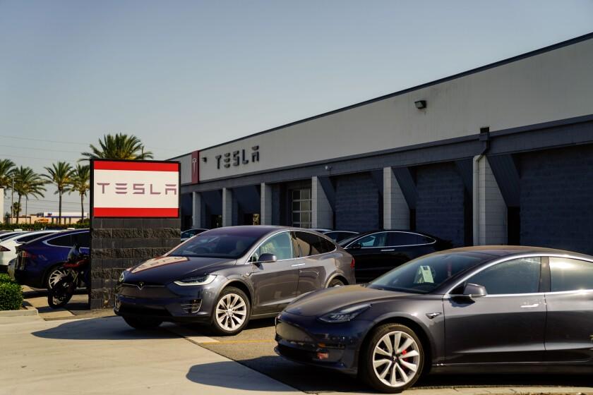 Several Tesla Model 3s parked outside a Tesla service center in Burbank.