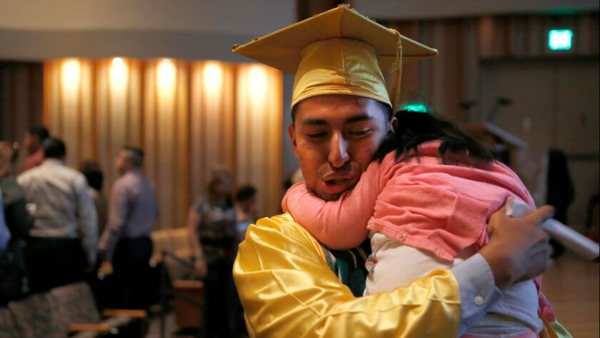 LOS ANGELES, CA. -- Friday, June 9, 2017 Bryan Pe–a, 18, hugs his younger sister after his high scho