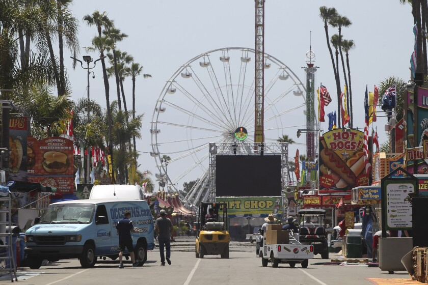 Workers prepare for the opening of the San Diego County Fair in 2019.