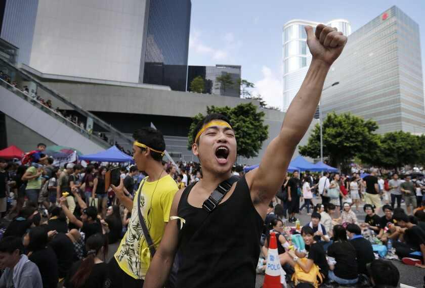 A pro-democracy activist shouts slogans near the government headquarters in Hong Kong where protesters were camped out Oct. 1.
