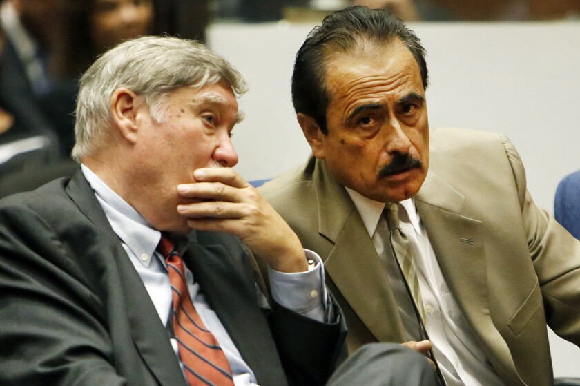 Former Los Angeles City Councilman Richard Alarcon, right, confers with his attorney while verdicts are read on voter-fraud and perjury charges Wednesday in Los Angeles Superior Court.