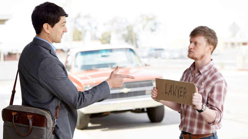 """Rookie lawyer Josh (Nicholas D'Agosto, left) meets his investigator Dwayne (Steven Boyer) in the new NBC situation comedy """"Trial & Error."""""""