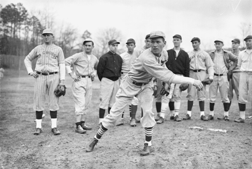 FILE - In this Feb. 18, 1935 file photo, Dizzy Dean gives a group of rookies a pitching lesson at a baseball school in Hot Springs, Ark. Some of baseball's most famous players spent time in Hot Springs, which was one of the first locations used for spring training, and visitors can check out spots