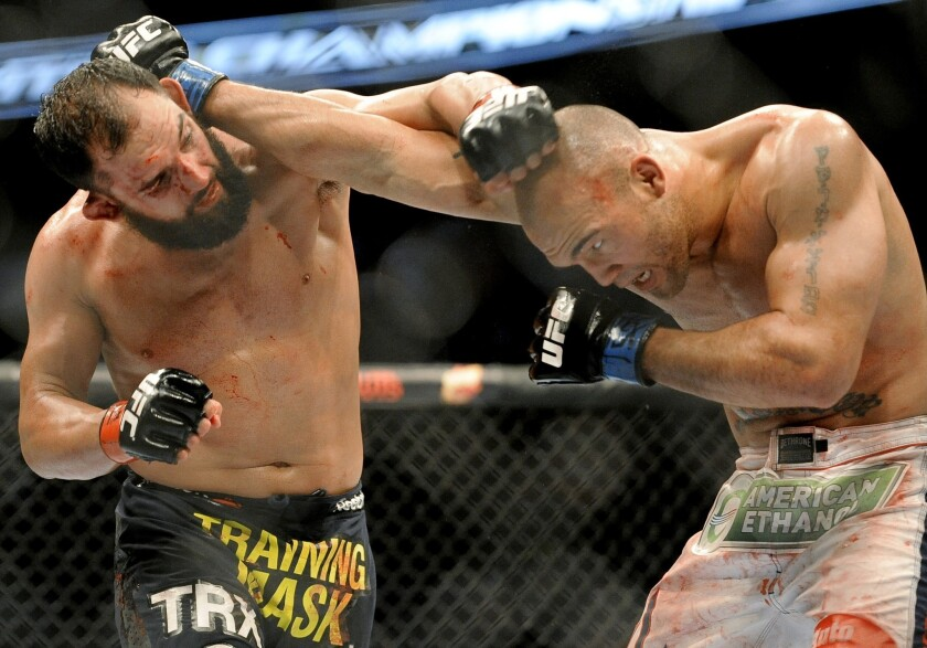 Johny Hendricks, left, won the UFC welterweight title with his unanimous decision over Robbie Lawler on Saturday night.