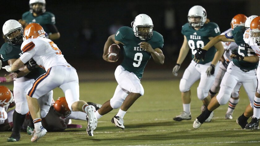 Helix senior running back Michael Adkins carries a 4.44 grade-point average and runs a 4.45 in the 40-yard dash.