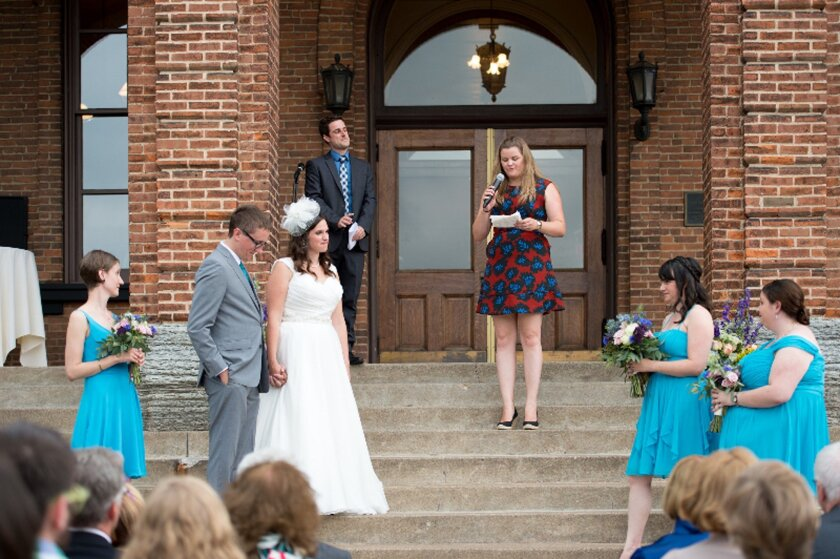 Ann Vardeman reads Justice Anthony M. Kennedy's words during the wedding of Chris Ernt and Jamie Lawler at the Washington County Historic Courthouse in Stillwater, Minn. on July 11, 2015.