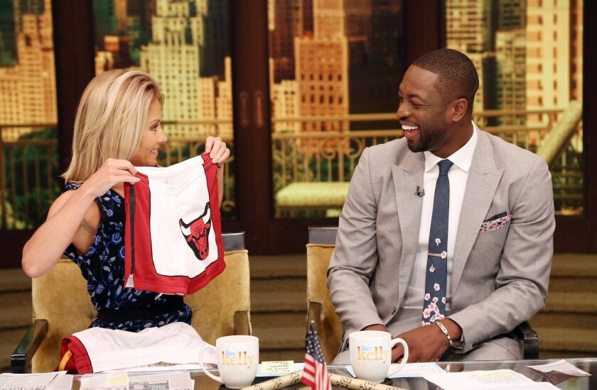 """In this image provided by ABC Home Entertainment and TV Distribution, TV host Kelly Ripa and NBA basketball player Dwyane Wade chat during the production of """"Live Kelly"""" in New York, Thursday, July 7, 2016. Wade decided Wednesday night, July 6, 2016, that he will leave the Heat after 13 seasons, ag"""