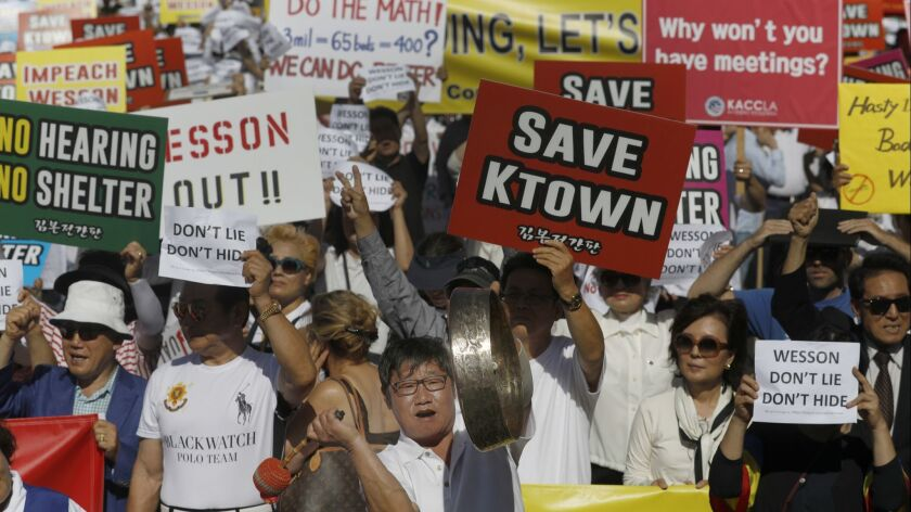 A crowd protests a city plan to set up a homeless shelter on Vermont Avenue in Koreatown on June 3.