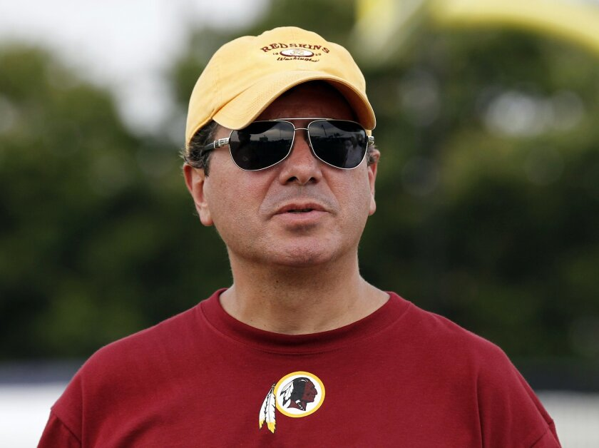FILE - In this July 27, 2014 file photo, Washington Redskins owner Daniel Snyder pauses on the field after football practice at the team's NFL football training facility in Richmond, Va. A long-running dispute over the Washington Redskins' team name will likely go another quarter. A Virginia judge