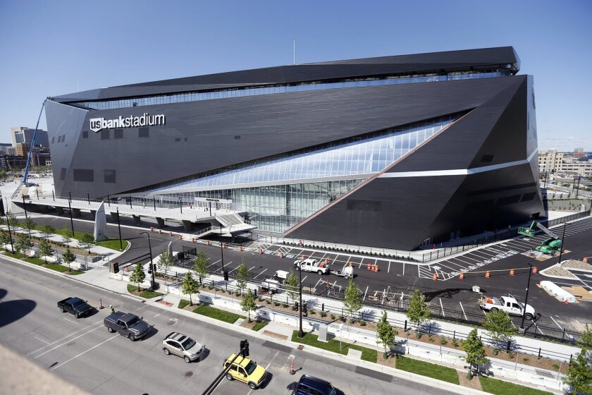 FILE - In this Thursday, June 2, 2016 file photo, finishing touches are made on U.S. Bank Stadium, the new home of the Minnesota Vikings NFL football team  in Minneapolis. The Vikings will open their 2016 season in the $1.2 billion stadium. The Minnesota Vikings can pick up the keys to their new ho