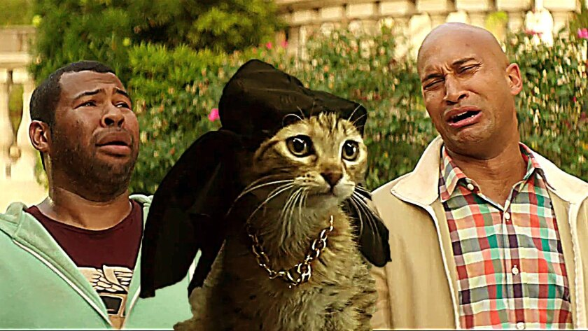"Jordan Peele, left, and Keegan-Michael Key with a magical cat in ""Keanu."""