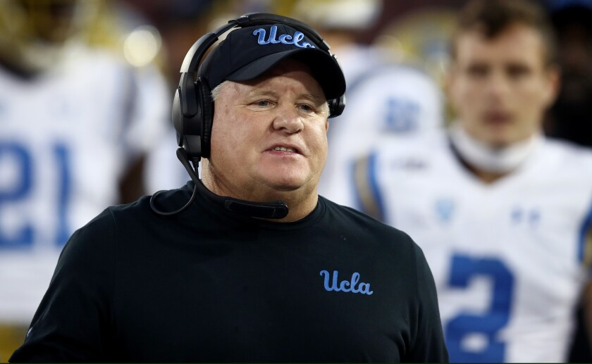 UCLA coach Chip Kelly stands on the sideline against Stanford.