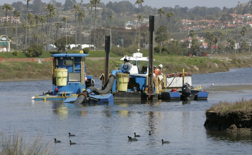 The lagoon undergoes dredging earlier this month in its western section near the Del Mar Fairgrounds.
