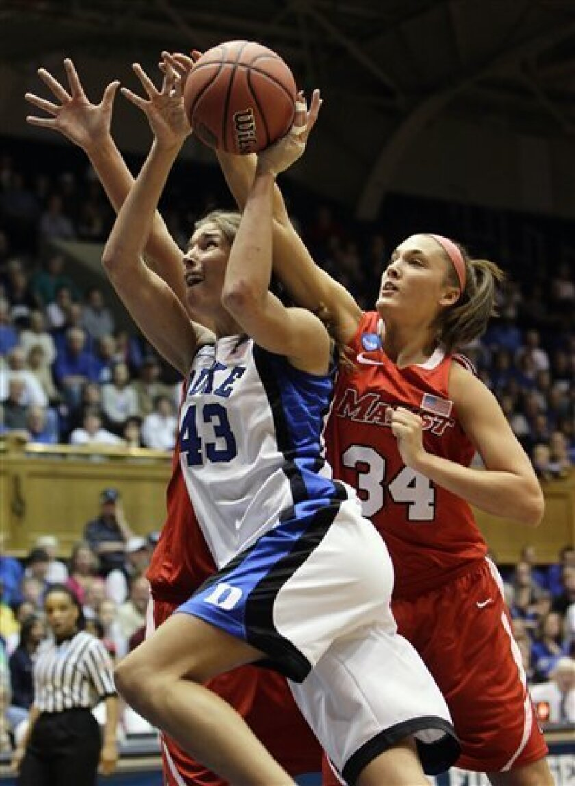 Duke's Allison Vernerey (43) drives to the basket as Marist's Brandy Gang (34) defends during the first half in the second-round of an NCAA women's college basketball tournament, Monday, March 21, 2011, in Durham, N.C. (AP Photo/Gerry Broome)