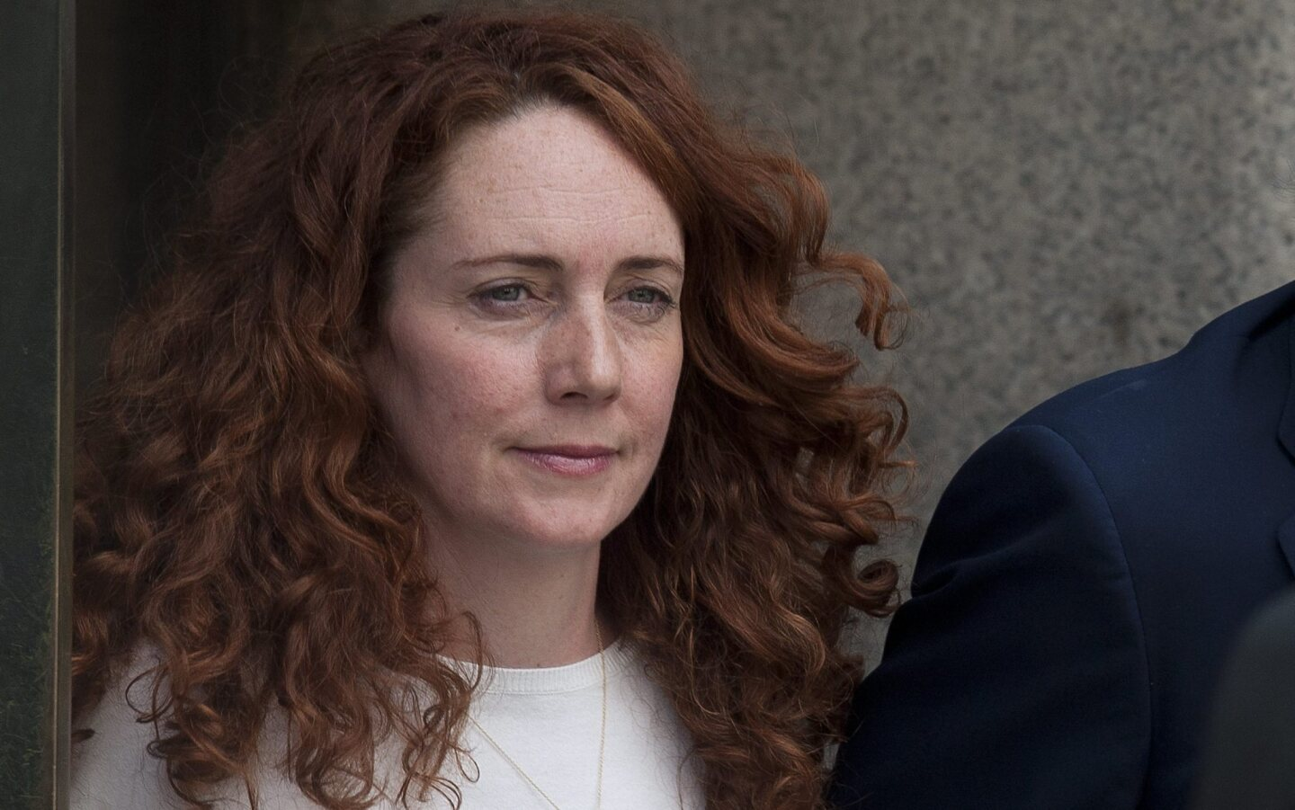 Rebekah Brooks leaves London's Old Bailey courthouse after verdicts were delivered Tuesday in a landmark phone-hacking trial.