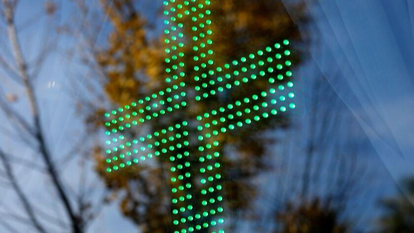 SHERMAN OAKS, CA - DECEMBER 28, 2017 -- The Green Cross is still lit in the main display window off