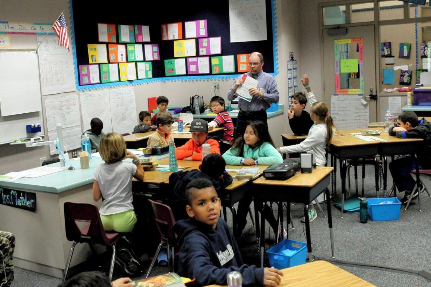 Publications director and editor Glenn Collins speaks to Mrs. Metzler's 4th grade class