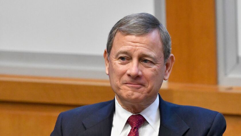 "Chief Justice Roberts rejects ""racial stereotypes"" in reopening a Texas death penalty case."