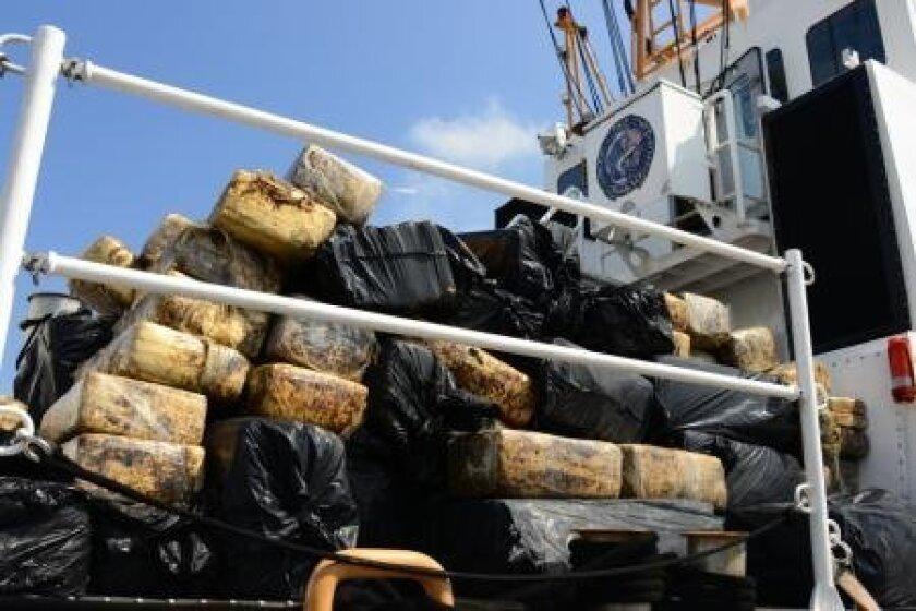 The Coast Guard unloads nearly 4,000 pounds of marijuana recovered from a fleeing panga boat.