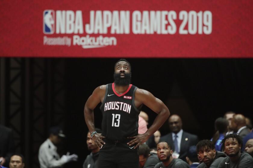 Houston Rockets' James Harden stands near the team bench during the first half of an NBA preseason basketball game against the Toronto Raptors Tuesday, Oct. 8, 2019, in Saitama, near Tokyo. (AP Photo/Jae C. Hong)