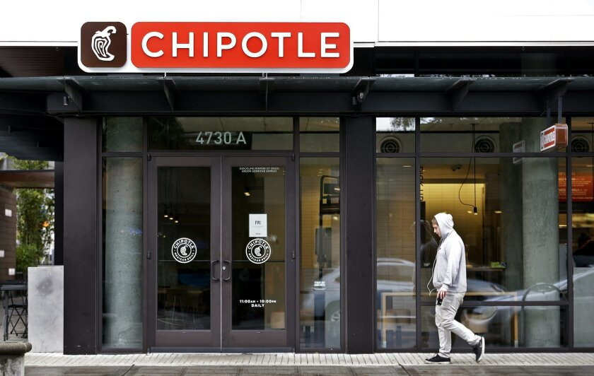 A pedestrian walks past a closed Chipotle restaurant Monday, Nov. 2, 2015, in Seattle. An E. coli outbreak linked to Chipotle restaurants in Washington state and Oregon has sickened nearly two dozen people in the third outbreak of foodborne illness at the popular chain this year. Cases of the bacte