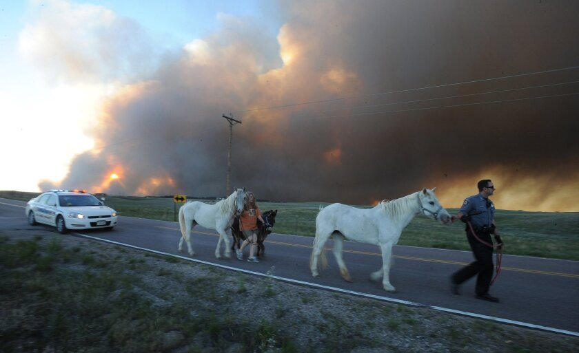 Colorado fires ignite dread, force dozens of emergency rescues - Los