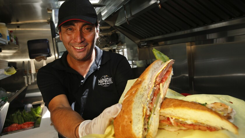 Carlos Leiva, chef and owner of the Mapuche Native Argentinian Food truck, with a lomito sandwich.