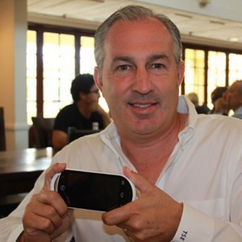 Rancho Santa Fe businessman T. Scott Edwards with the MG, his new portable gaming device.