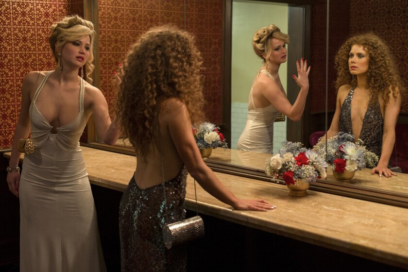 Jennifer Lawrence, left, as Rosalyn Rosenfeld and Amy Adams as Sydney Prosser in the Grand Old AC Hotel powder room.