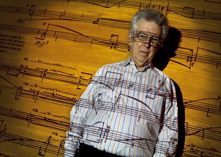 "Roger Reynolds, University of California San Diego composer, in recording Studio A with a portion of the music score,""Giverny,"" from the Newstring Quartet called ""Not Forgotten"" projected on his body."