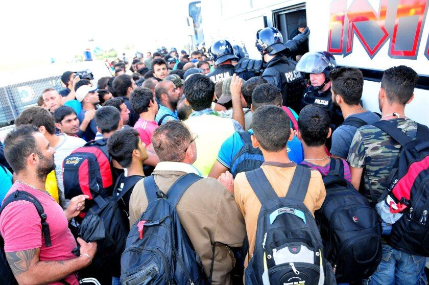 Migrants arrive at the border crossing between Obrezje in Slovenia and Bregana in Croatia on Sept. 19.